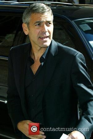 Clooney Mourns Beloved Pig Max