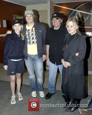 From left: Lee Furlong of Fox Sports, cricketer Shane Watson, and Terry and Vicki Furlong (parents of Lee Furlong) The...
