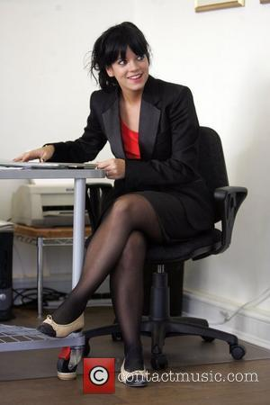 Lily Allen looks every bit the sexy secretary in her suit and specs, as she spends the morning at a...