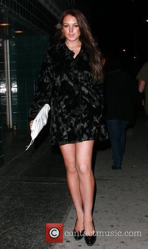 Lohan Denies Dating Co-stars