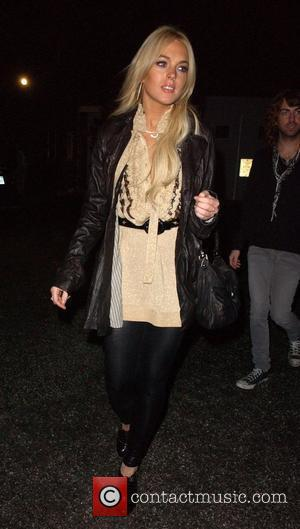 Lohan Sued By Photographer