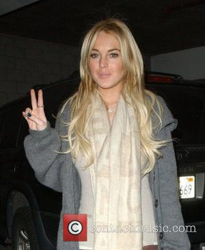 Rivals Lohan And Hilton Watch Madonna