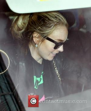 Lindsay Lohan  arrives at a McDonalds drive-thru window while running errands with her assistant Los Angeles, California - 06.05.08