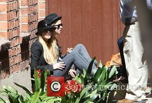 Lindsay Lohan and Samantha Ronson Taking A Break At The Back Of A Medical Centre In Beverly Hills