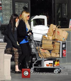 Ali Lohan and Lindsay Lohan go grocery shopping and then head to Sunset Plaza in Hollywood Los Angeles, California -...