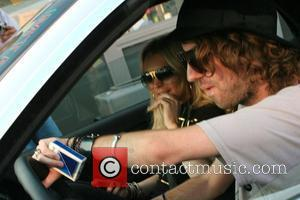 Lohan 'Happy' Over Vanity Fair Controversy