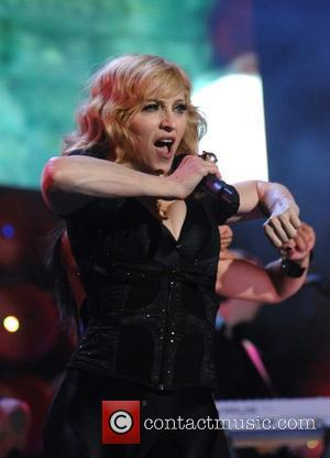 Madonna's Curse-laden Induction Acceptance