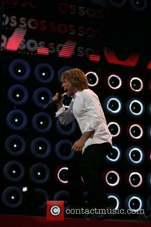 Bon Jovi Recreates Bad Name For Rapping Footballer