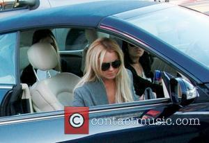 Lohan Staying With Her Mother