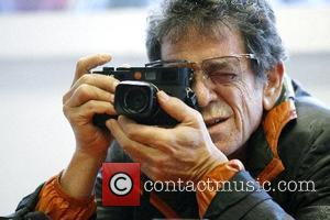 Musician, rock singer and photographer Lou Reed open his photo exhibition entitled ' Lou Reed's New York ' at gallery...