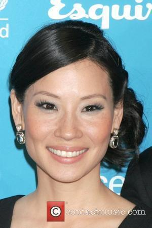 Lucy Liu, UNICEF Ambassador  2008 UNICEF and Esquire Nationwide 'Tap Project' held at the Hearst Tower New York City,...