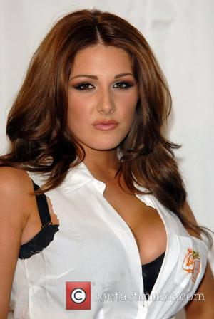 Lucy Pinder judging the competition 'The Rustlers Real Men Games' to find 'real men'. The contest includes a series of...