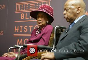 Chair of the National Council of Negro Women, Dorothy Height and Representative John Lewis are honored at the unveiling of...