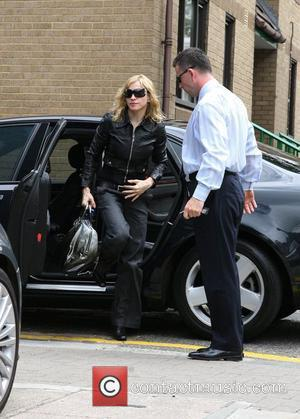 Madonna Adoption Attacked By Neeson