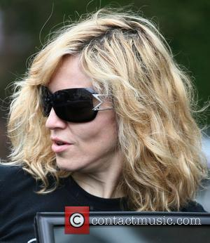 Madonna leaving the gym. Her hands are showing their age and are looking very veiny. She is also wearing a...