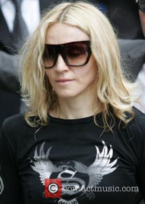 Grant Praises Madonna's Directorial Skills