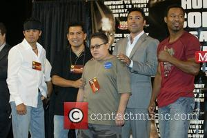 Oscar De La Hoya meets Cruz Baraja as party of the Make A Wish Foundation. The foundation makes it possible...