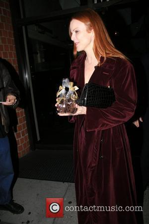 Marcia Cross and Tom Mahoney Leaving Mr Chow Restaurant