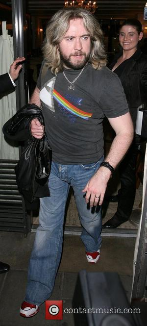 Justin Lee Collins leaving Cipriani restaurant. London, England - 04.04.08