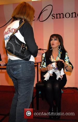 Marie Osmond signs her doll from the Marie Osmond Doll Collection at Boscov's in Langhorne Pa Philadelphia, Pennsylvania - 16.02.08