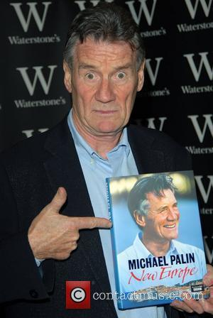 Michael Palin  signs copies of his latest book 'New Europe' at Waterstones book store in Oxford Street London, England...