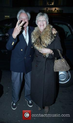 Michael Winner and his wife arriving at Cipriani's in Mayfair in his Phantom Rolls Royce. A cab would not move...