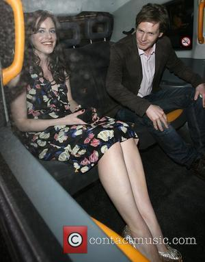 Michelle Ryan and a male companion leave the VIP screening of 'Cashback' held at Odeon Covent Garden.
