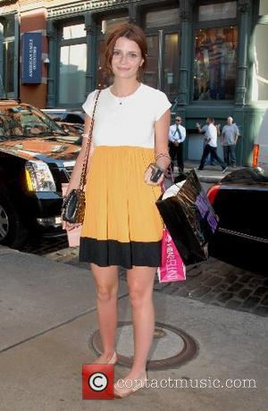 Mischa Barton got a little sunburned while out shopping in SoHo. She even left one store wearing a new outfit....