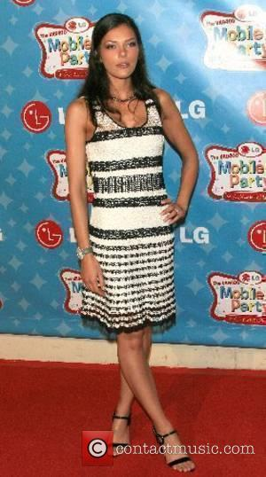 Adrianne Curry LG Mobile Phones presents LG's Mobile TV Party, a salute to the beloved TV shows and stars of...