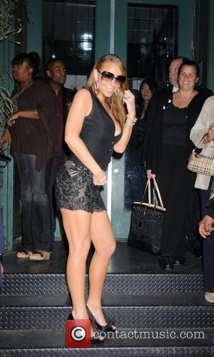 Mariah Carey leaving her private party at Mr Chows to celebrate her album E=MC2 going to number 1 in America...