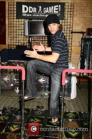 Justin Guarini tries the popular dancing arcade game, Dance Dance Revolution Melanie Segal's 2007 MTV Movie Awards Platinum Luxury Lounge...