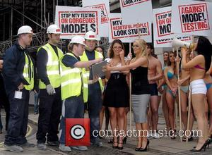 Lucy Pinder and Kayleigh Pearson Glamour models, accompanied by 16 of their bikini-clad comrades, stage a  mock protest against...