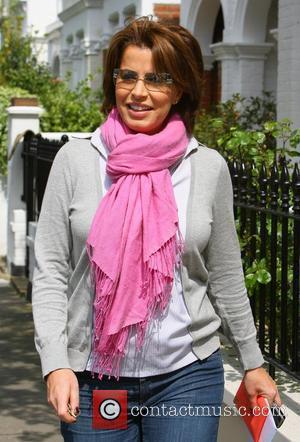 Natasha Kaplinsky wearing a bright pink scarf visits her local hair salon London, England - 02.05.08