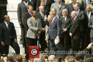 President George W Bush with the Super Bowl winners the New York Giants at The White House Washington DC, USA...