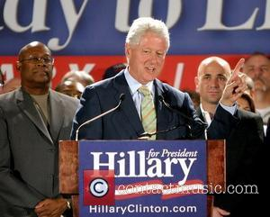 Former President of United States Bill Clinton and Andre Agassi Former President of United States Bill Clinton campaigns for his...