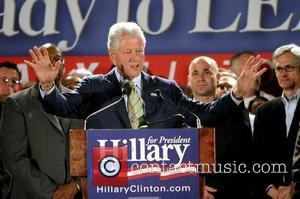 Bill Clinton, Andre Agassi and Hillary Clinton