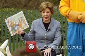 First Lady Laura Bush reads to children  The annual White House Easter Egg Roll on the South Lawn of...