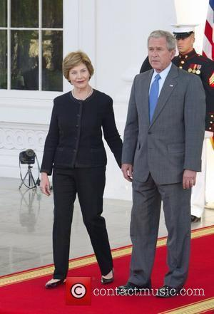 First Lady Laura Bush and US President George W. Bush  welcome British Prime Minister Gordon Brown and his wife...