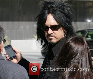 Nicky Sixx leaving the Los Angeles Superior Court with his iPhone Los Angeles, California - 04.02.08