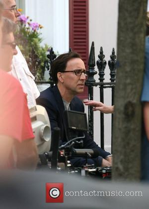 Nicolas Cage enjoying a break from filming on location in Primrose Hill for his latest movie 'National Treasure 2' London,...
