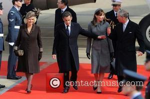 French president Nicolas Sarkozy arrives at Heathrow Airport with his wife Carla Bruni and was greeted by the Prince Charles,...