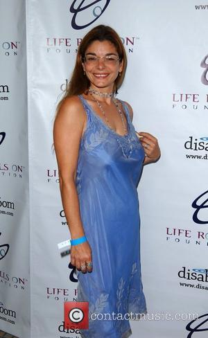 Laura San Giacomo The 4th Annual Night by the Ocean Gala at the Beverly Hills Hotel.  Los Angeles, California...