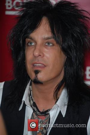 Nikki Sixx bassist and songwriter for rock band Motley Crue, signs copies of his new book