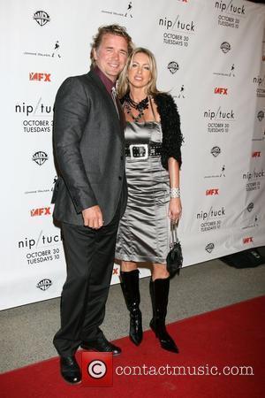 John Schneider and Wife Nip/Tuck Season 5 Premiere Screening held at the Paramount Theatre Hollywood, California - 20.10.07