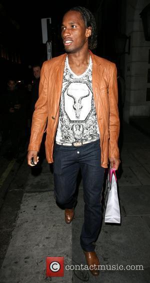 Didier Drogba, Chelsea, Ivory Coast Striker Leaving Nobu Berkeley Street Restaurant and Carrying A Yves Saint Laurent Bag.