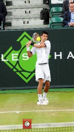 Novak Djokovic Tennis player Novak Djokovic plays against Jamie Baker in the Boodles tennis tournament, held at the Stoke Park...