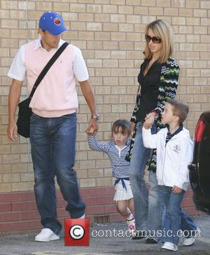 Phil Neville and family Manchester United players arrive at Old Trafford to watch the Manchester United vs Reading game. Manchester,...