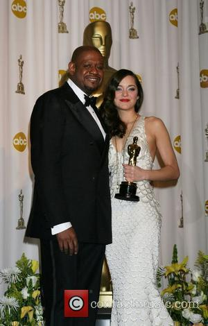 Marion Cotillard and Forrest Whitaker