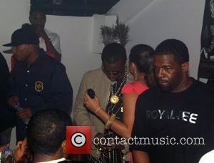 Sean Combs aka P Diddy and his entourage promoting his Sean John clothing line at Ibiza Nightclub DC. Washington DC,...
