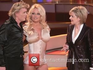 Hans Klok and Pamela Anderson